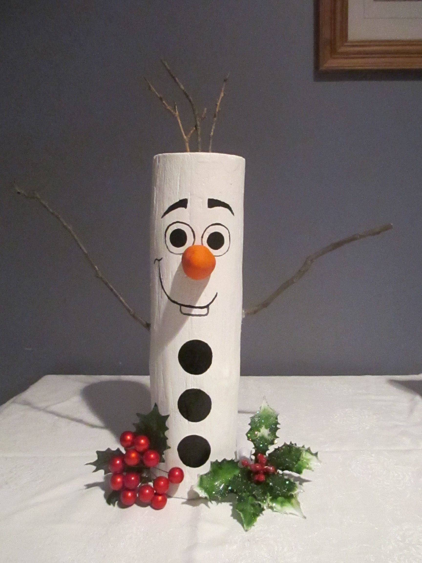 """Olaf, the Log Snowman, was newly handcrafted and hand painted and and entirely from tree logs. He stands approximately 15"""" tall and weighs 3 lbs. Created with love in a smoke free home. Sells for $10.00."""