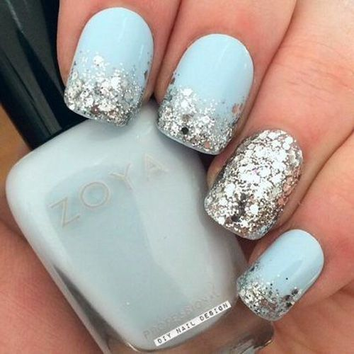 Light blue nails with silver glitter
