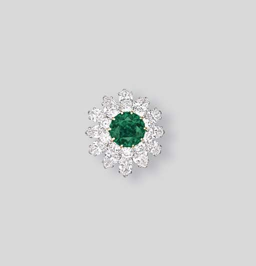 AN EMERALD AND DIAMOND RING, BY VAN CLEEF & ARPELS  Centering upon a circular-cut emerald weighing 6.25 carats within a brilliant, pear and marquise-cut two-tiered surround, to the brilliant-cut diamond shoulders, mounted in platinum