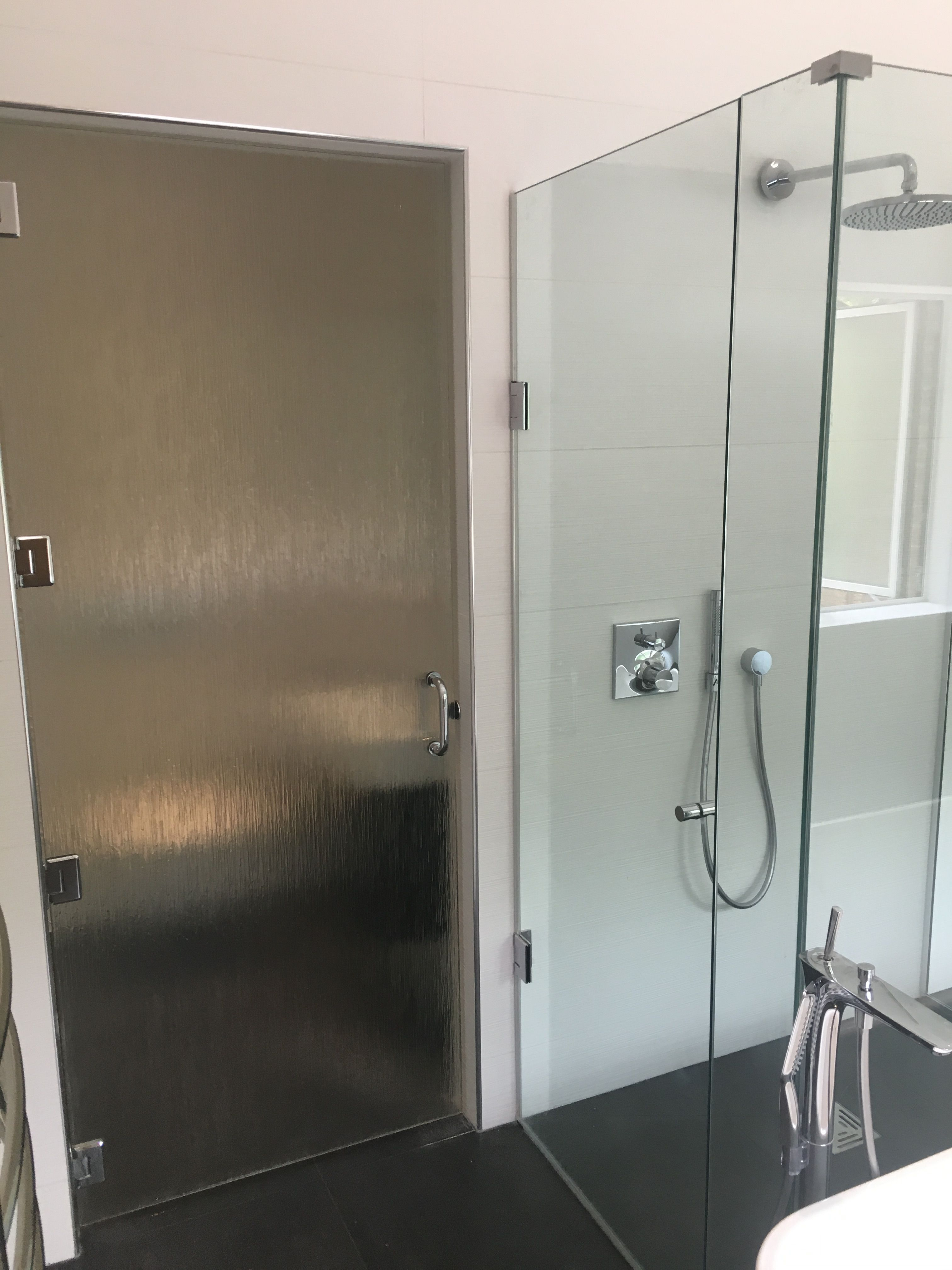 Frameless 3 sided shower enclosure and reeded glass bathroom door ...