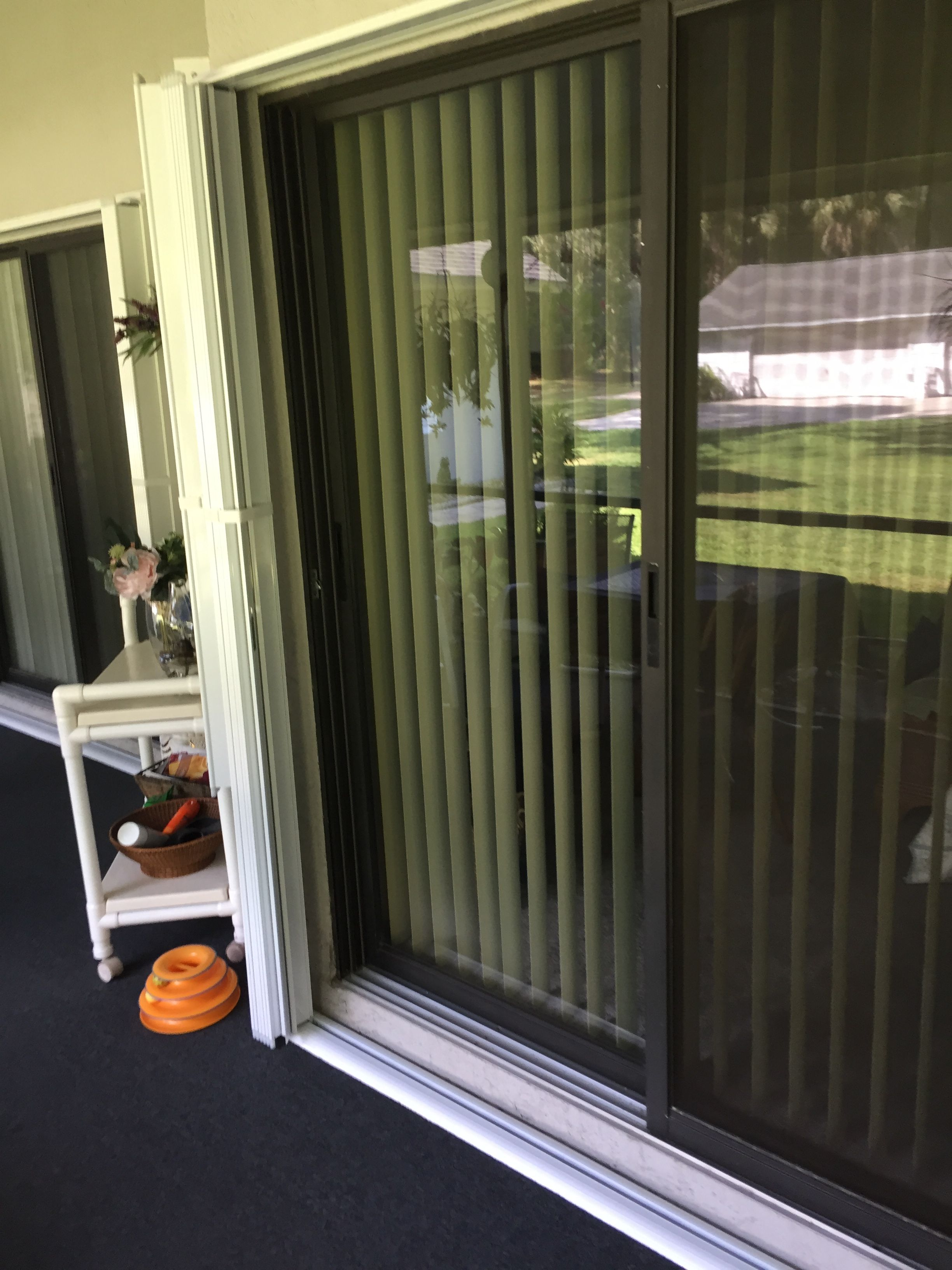 Accordion Shutters Commonly Called Folding Shutters The Most Popular Application For Accordion Storm Shutt Sliding Glass Door Glass Balcony Hurricane Shutters