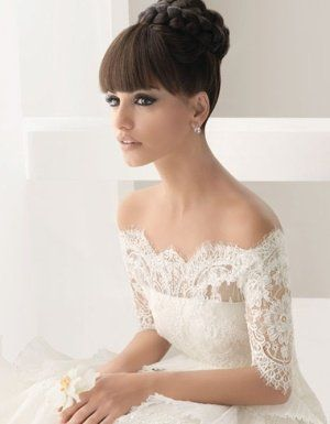 Wedding dress with lacy neck line. | WefollowPics
