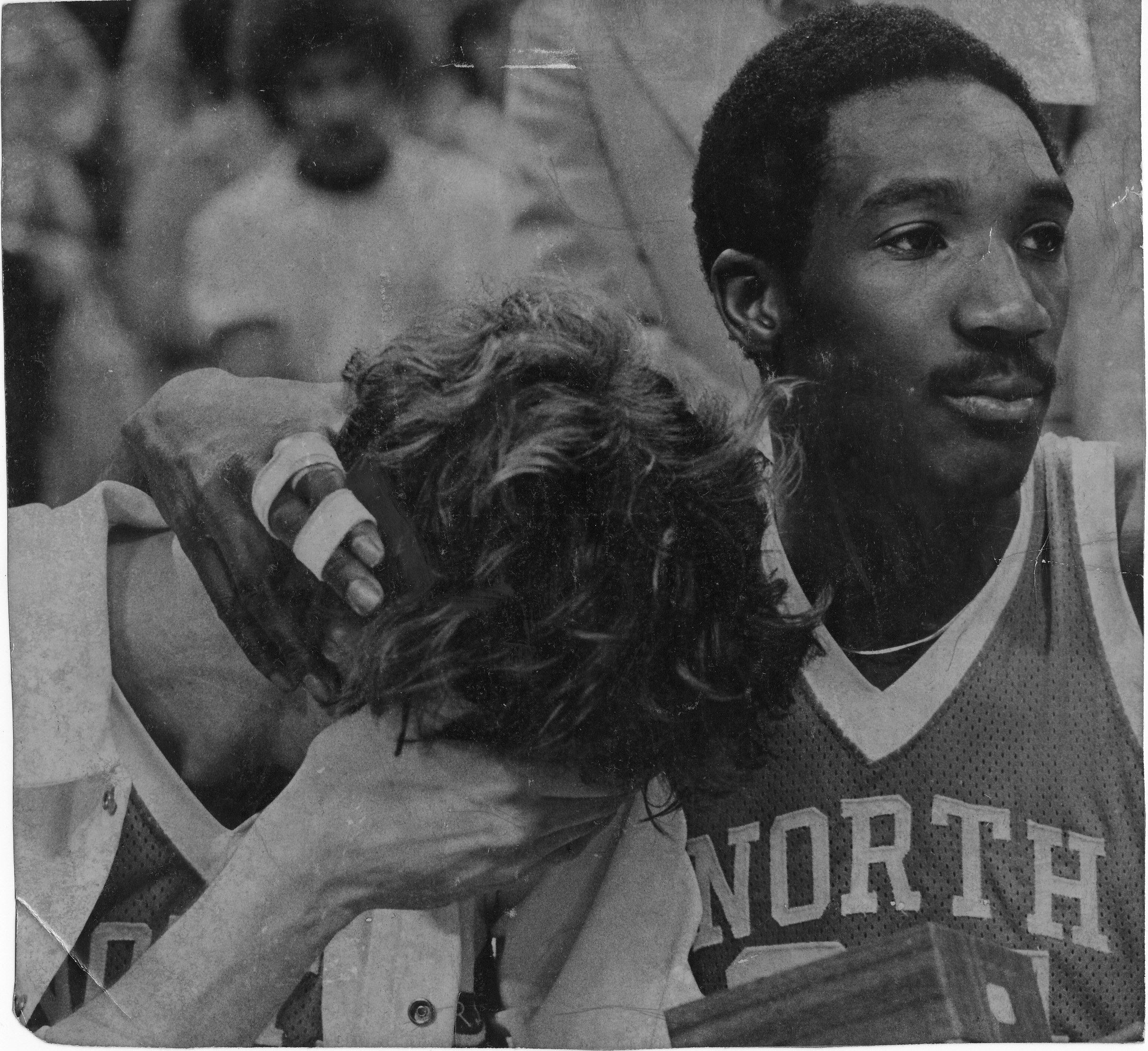 Walter Davis consoles Mike O Koren after UNC s loss to Marquette