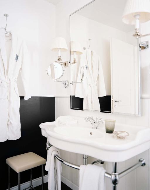 Black and white bath chrome base sink sconces swing for Black sconces for bathroom