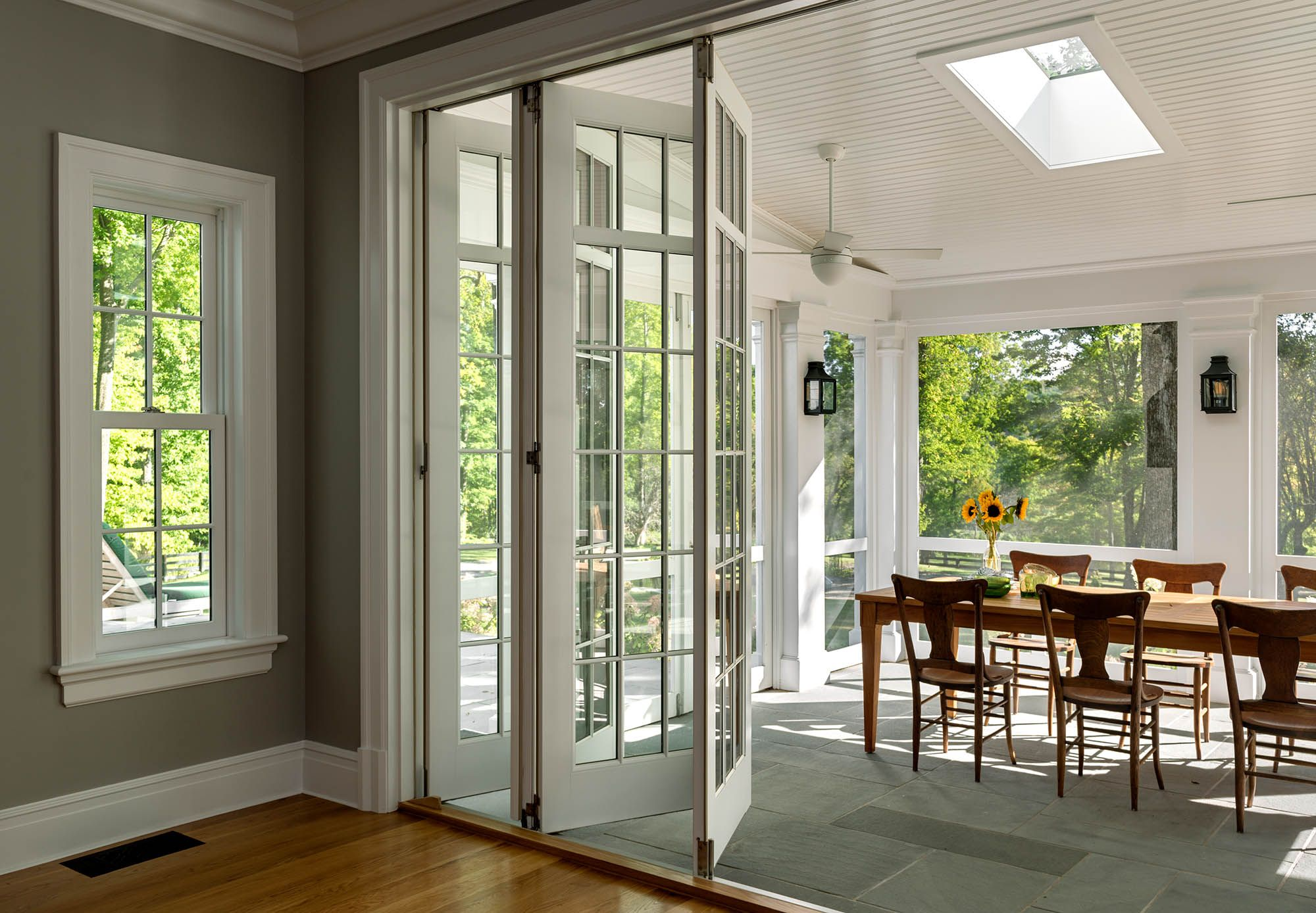 Make Your Living Room Bigger With Sliding Glass Paneled Walls Crisp Architects House With Porch Folding Glass Doors Screened Porch