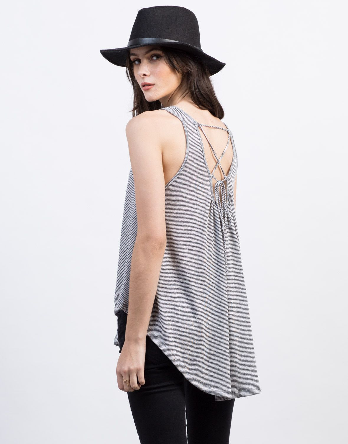 This striped Lace-Up Back Flowy Top features the lace-up details in back that you've been waiting for. Perfect for a casual date with a fedora hat, white shorts, and sandals! Total nautical beach babe look.