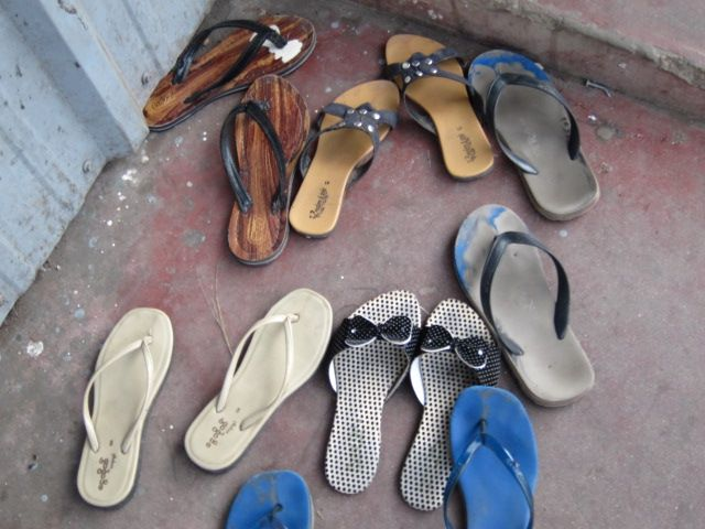 Slippers at the factory door.
