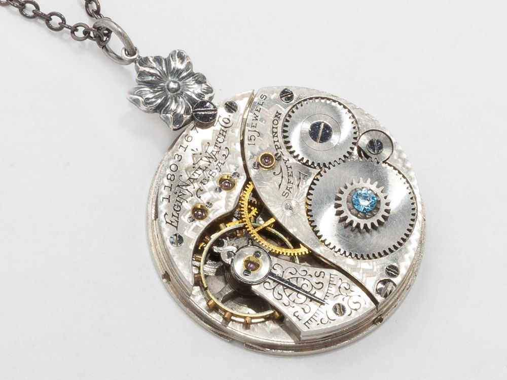 Steampunk pocket watch necklace featuring an Elgin clockwork silver flower and aquamarine blue crystal #SteampunkNecklace  #SteampunkJewelry #SteampunkJewelrybyMariaSparks