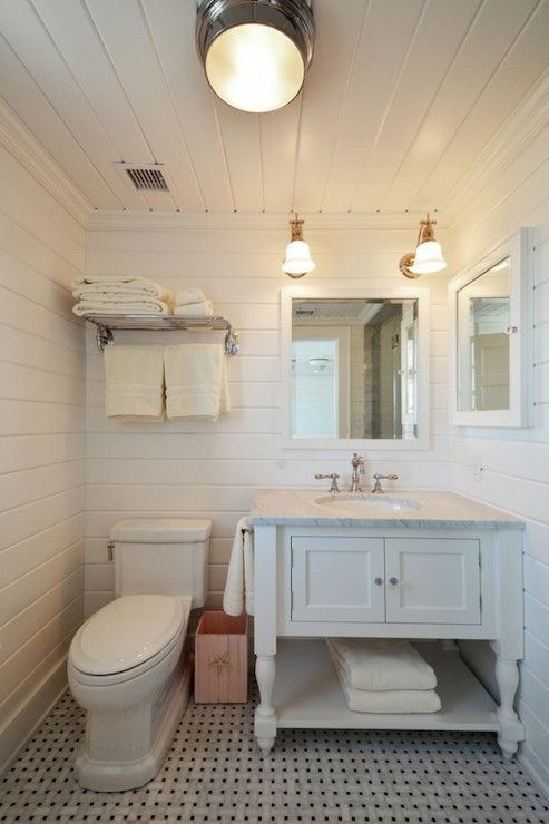 Beach Cottage Bathroom Features Tongue And Groove Ceiling Over Grooved Walls Framing Train Rack Over Toi Beach House Bathroom Cottage Bathroom Shiplap Bathroom
