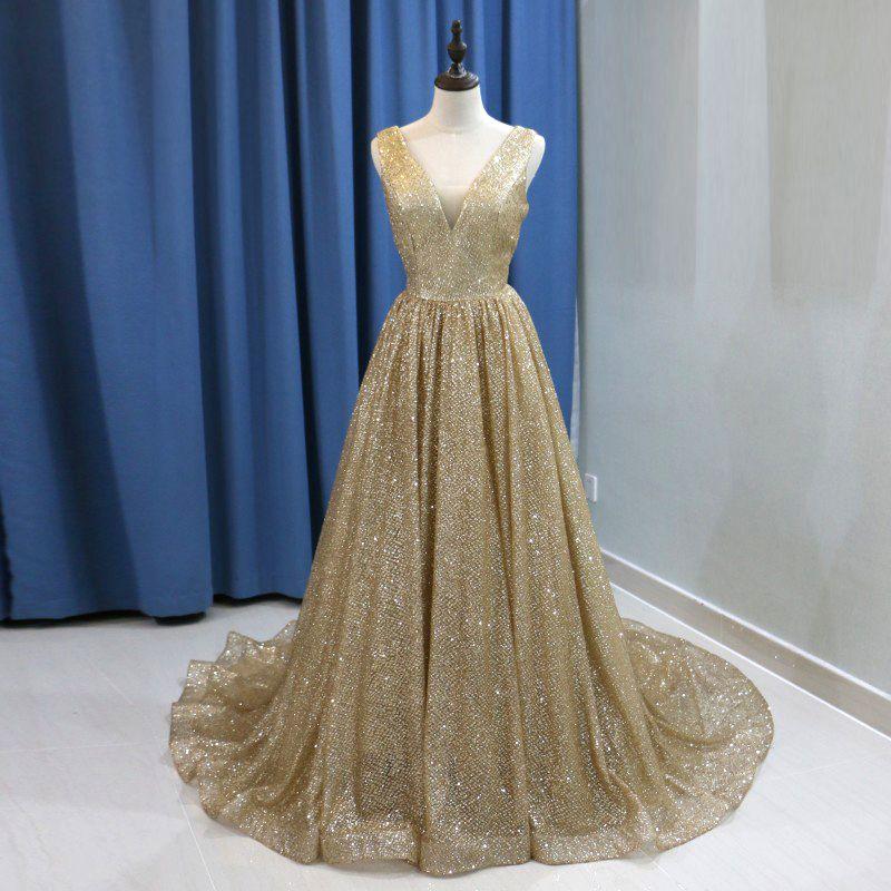 8143016341e Sexy Gold Sequin Arabic Evening Dress 2019 Long Dubai Prom Dresses V-neck  Backless Plus Size Women Formal Gowns