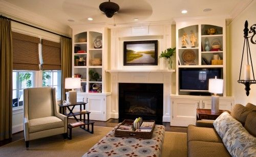 To Me Bookshelves Always Make For An Inviting Space I Like The Curved Lines On Fireplace Built Ins Built In Around Fireplace Traditional Design Living Room