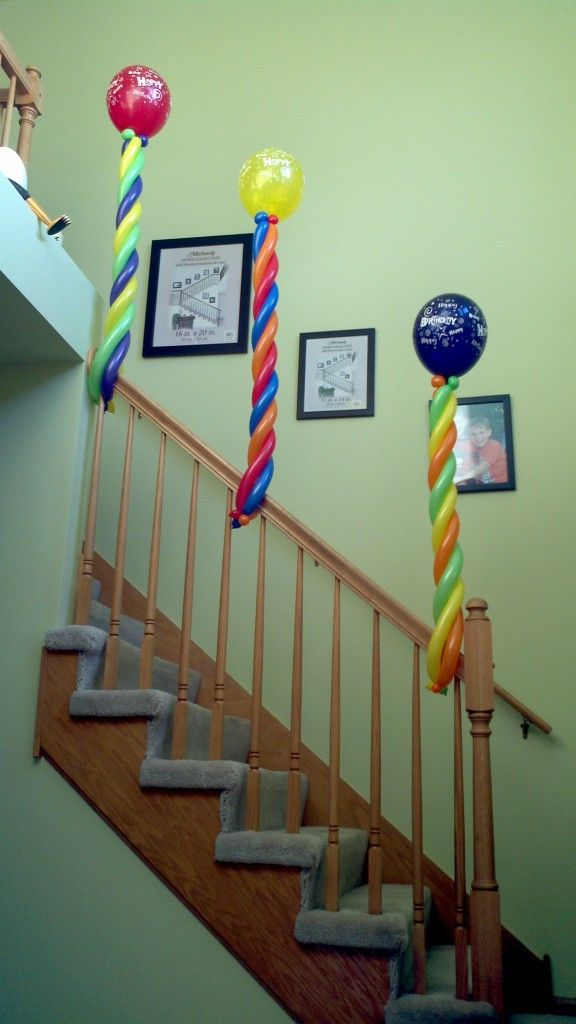 Quick air filled stair railing decoration for the home for Air filled balloon decoration ideas