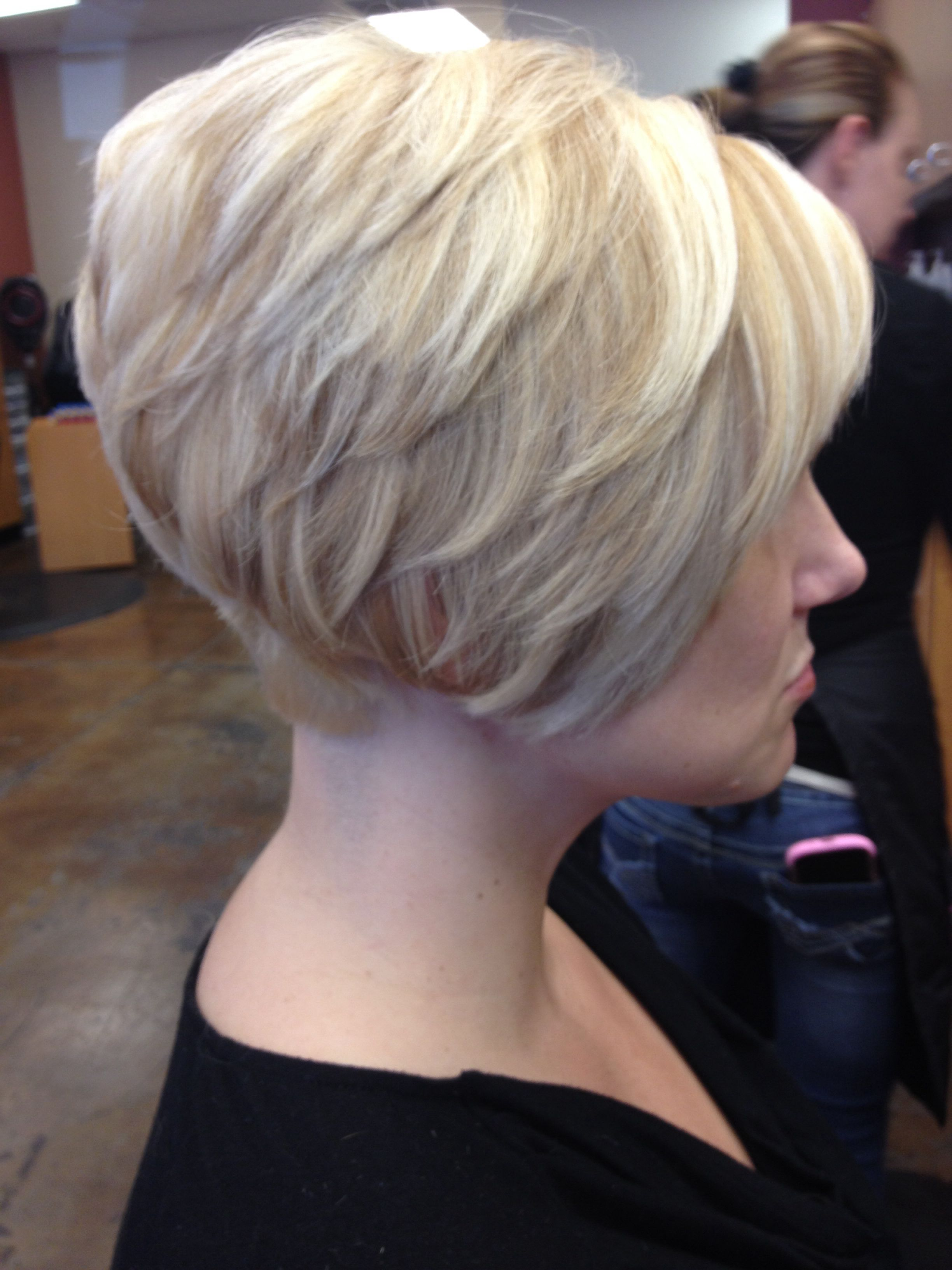 Short tapered bob platinum base with golden blonde lowlights and