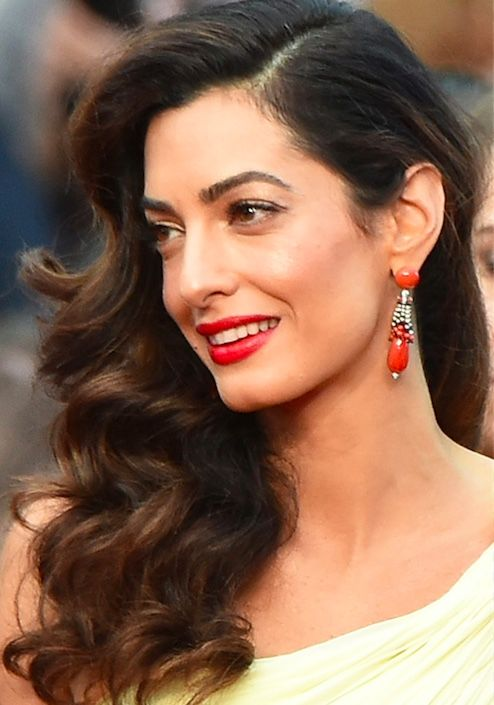 Amal chose a head-turning, one-shoulder yellow Atelier Versace gown featuring a thigh-high slit and attached train. Bright red lips and Cartier drop earrings complemted the look. Amal also channeled Old Hollywood glam vibe with side-swept waves (crafted by Blake Lively's mane master, Rod Ortega).