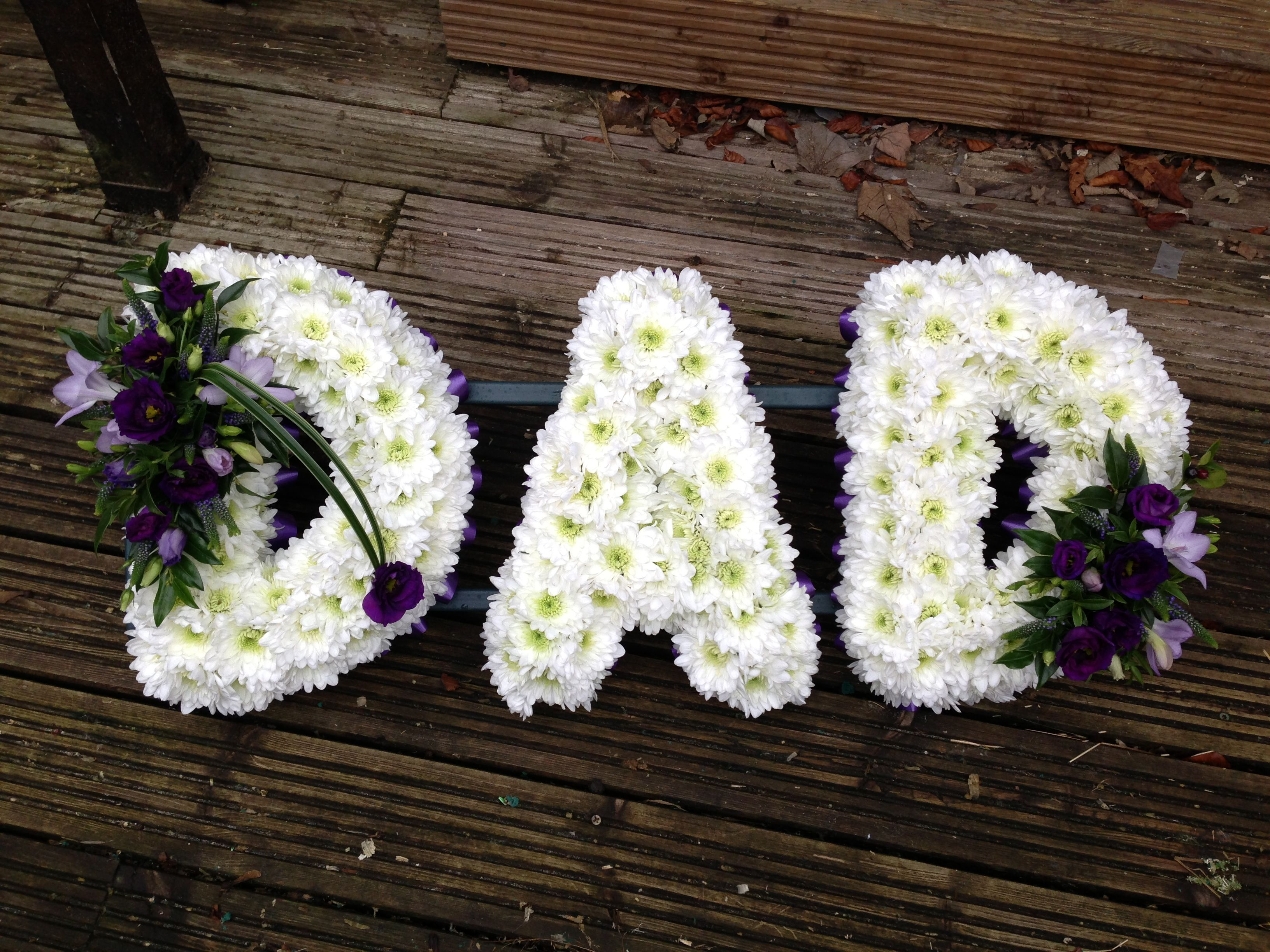 Beautiful Dad funeral wreath purple and white made by daughter all the best