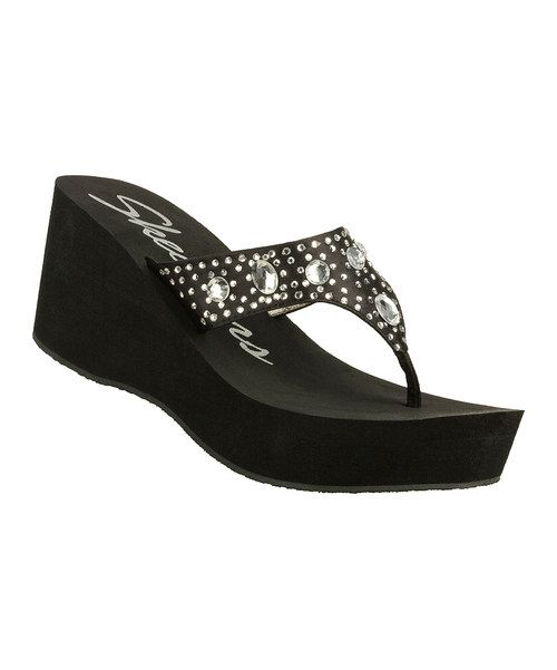 Gleaming rhinestones bedazzle the sleek upper of this wedge. Styled with a sculpted foam wedge and traction sole, this wedge is beach-ready and style savvy.2.75'' heel with 1.25'' platformFabric upperRubber soleImported