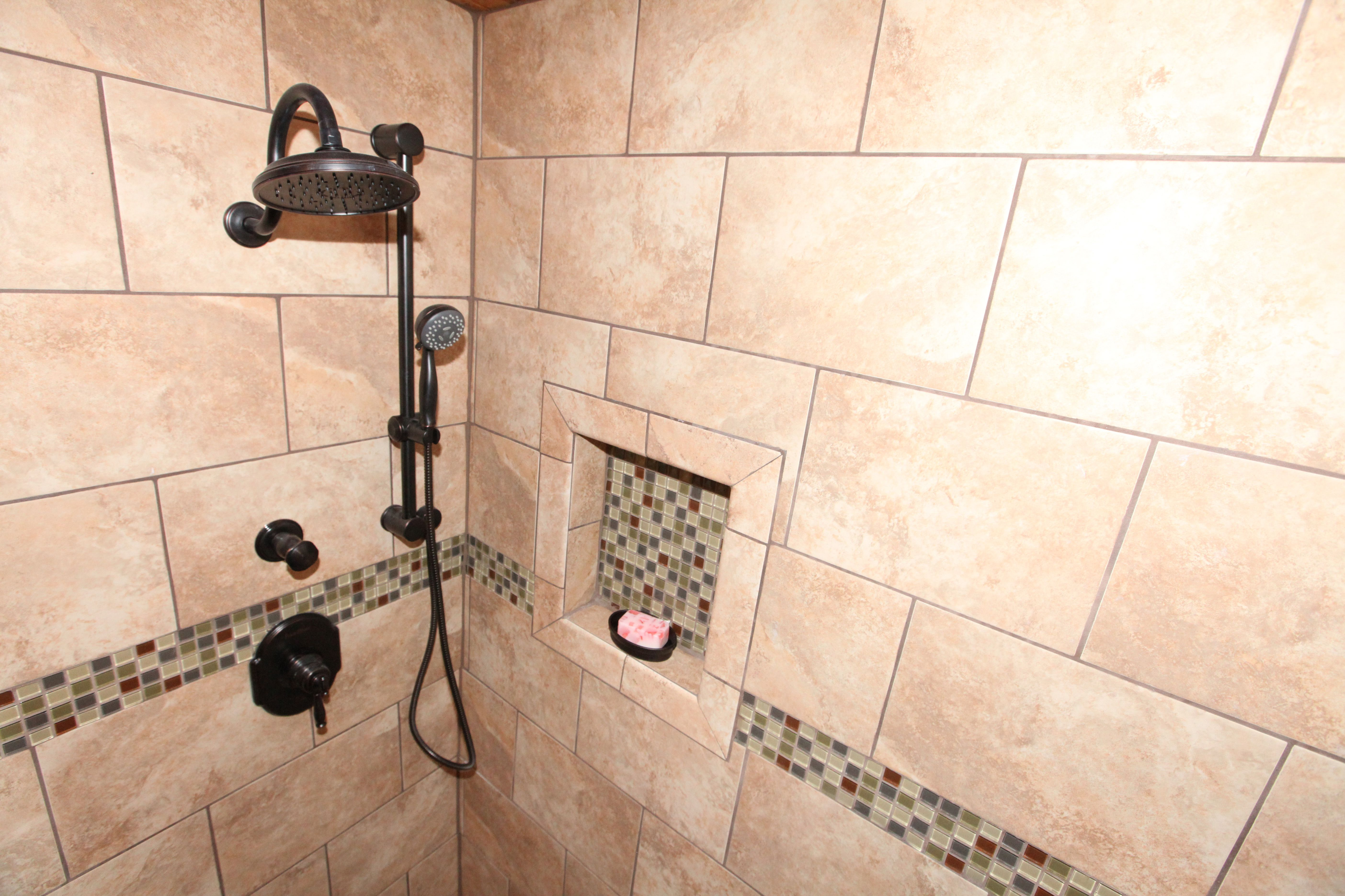 Tiled shower with 9x12 and a 4x12 deco glass tile with a for Bathroom ideas 9x12