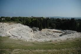 Neapolis Archaeological Park near Siracusa--Greek Theater built in 5th century BC--completely cut from bedrock & will hold 15,000 people.  You can see the sea in the distance.