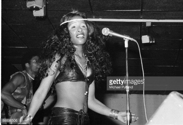 Singer Chaka Khan performing with American funk group Rufus at a record launch party in London, February 1975. On the left is bassist Dennis Belfield.