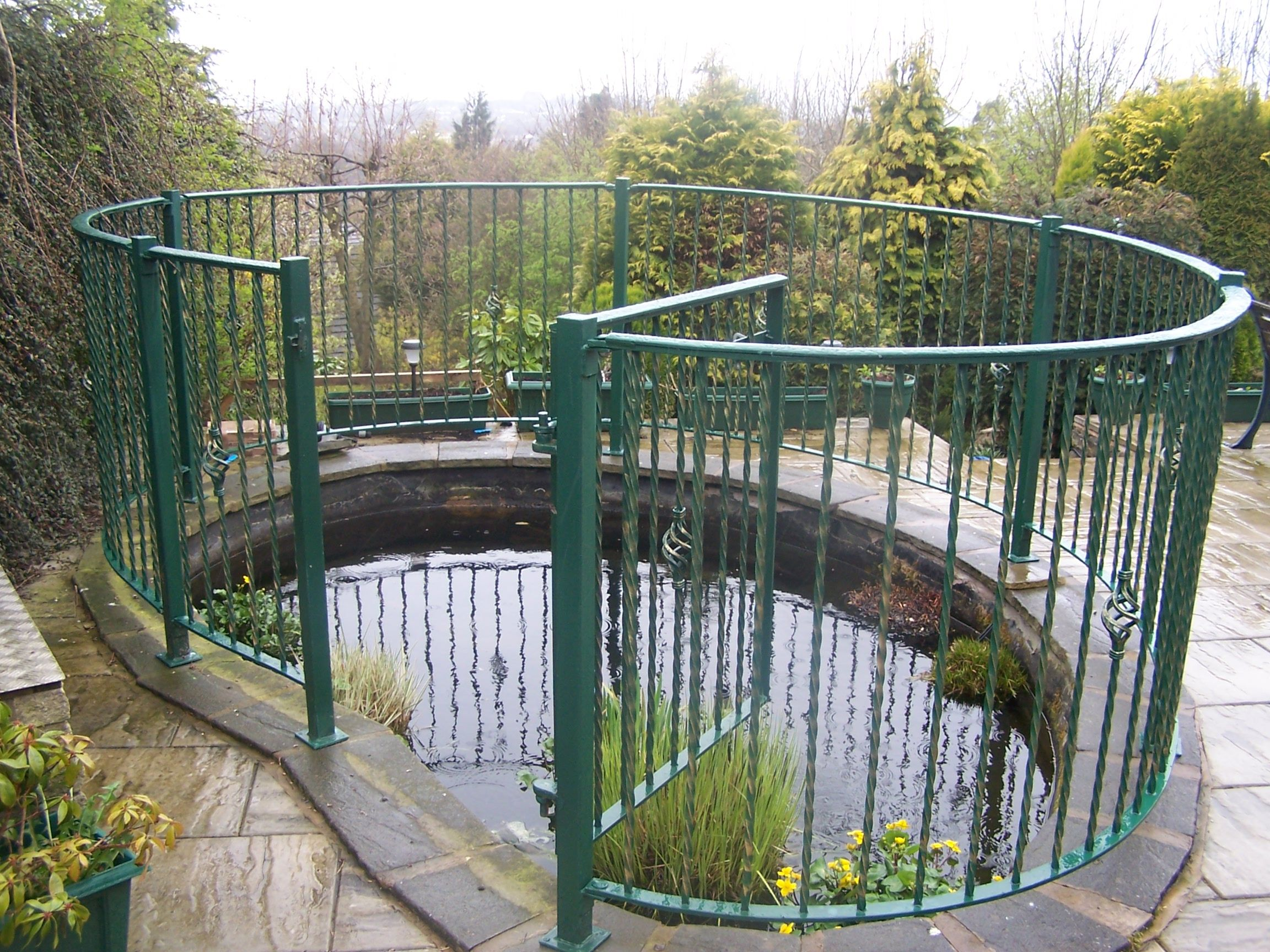 Garden pond railings to ensure safety but still access for