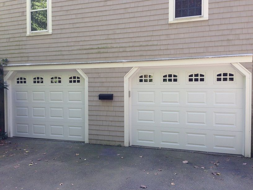@C.H.I. Overhead Doors Model 2216 Steel Raised Panel Garage Doors In White  With Cascade Glass