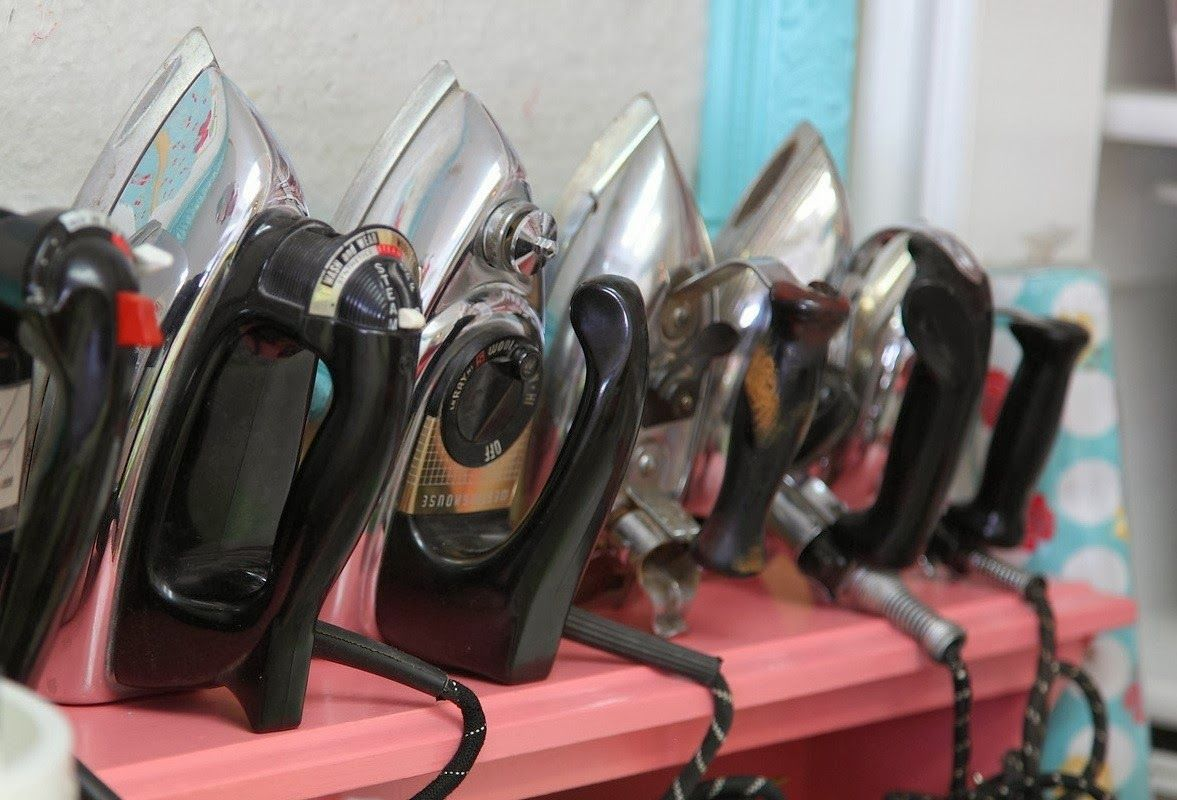 Vintage irons from Lori Holt's sewing space. Her studio is full of vintage  charm!