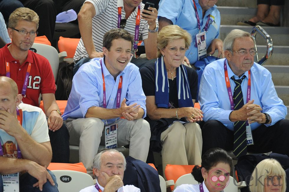 Prince Frederik of Denmark, and King Constantine and Queen Anne-Marie of Greece watch voleyball