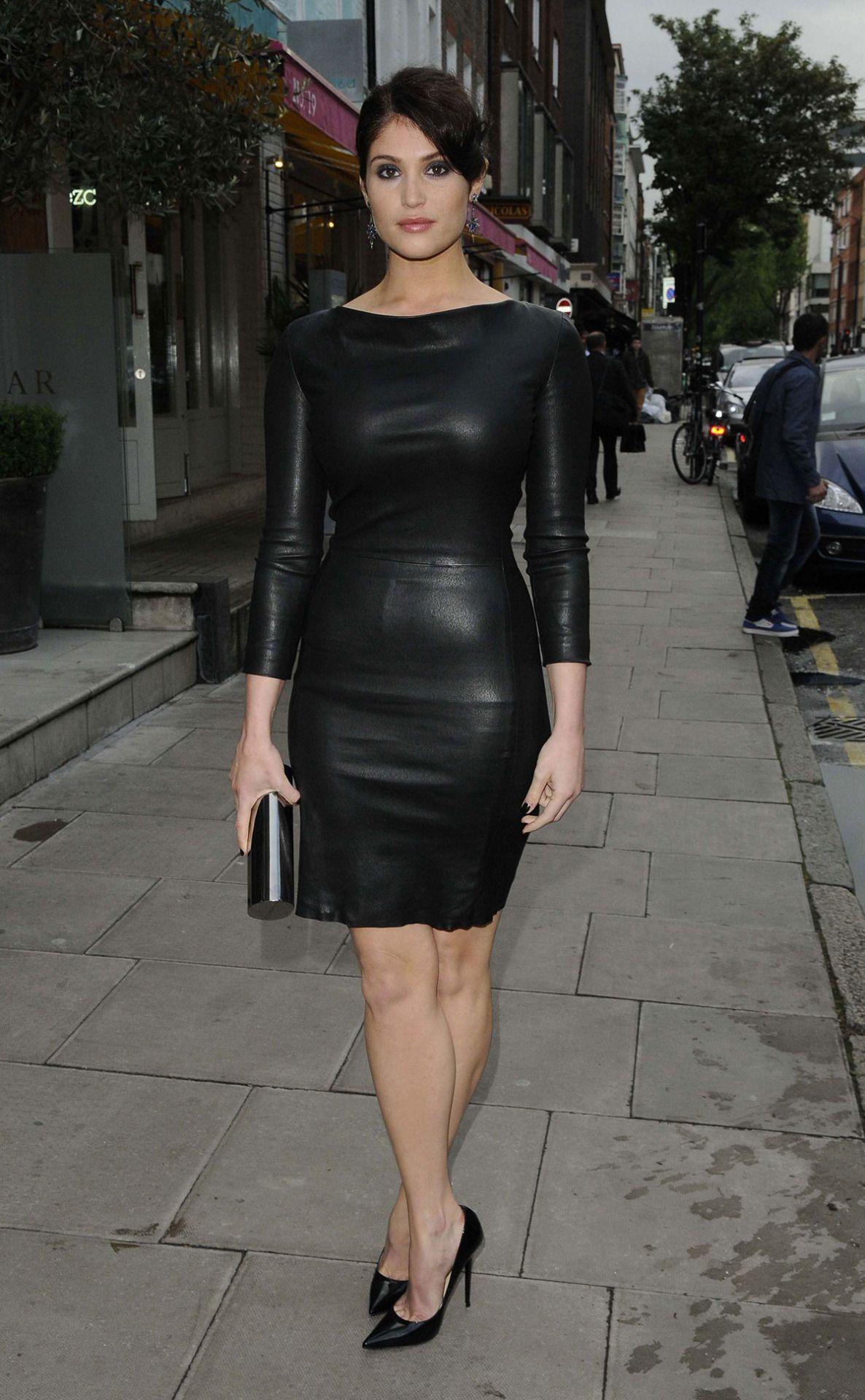 Gemma Arterton looks damn hot in a black leather dress