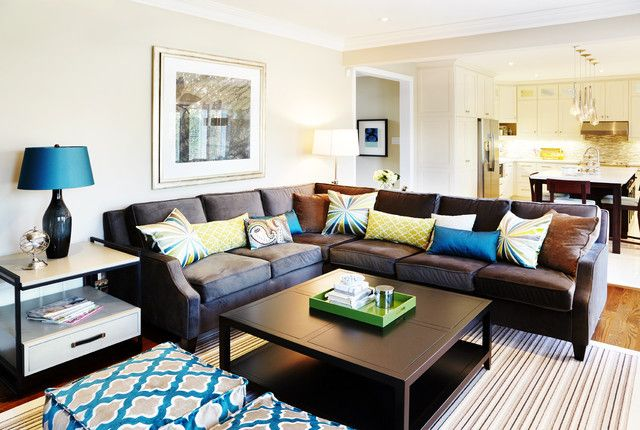 Terrific Traditional Family Room Design with Dark Colored Leather Sectional Sofa and Black Desk Lamp with Cyan Cover
