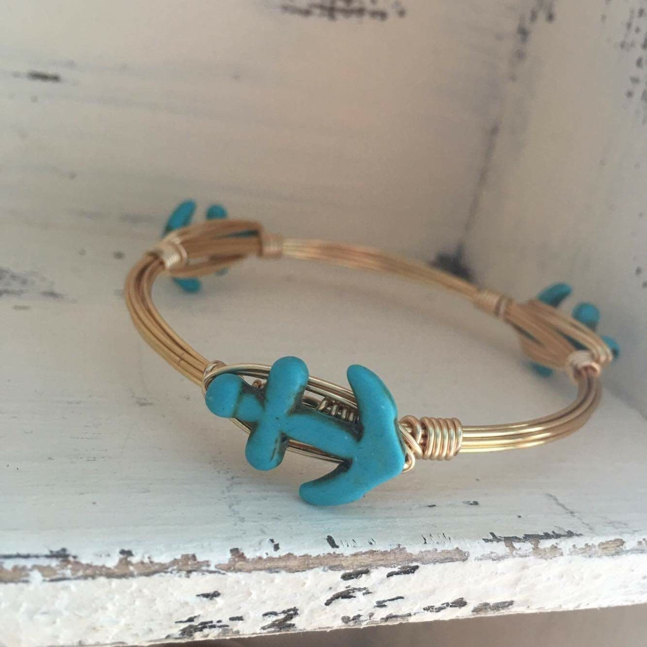 A personal favorite from my Etsy shop https://www.etsy.com/listing/472243701/small-turquoise-anchor-bangle