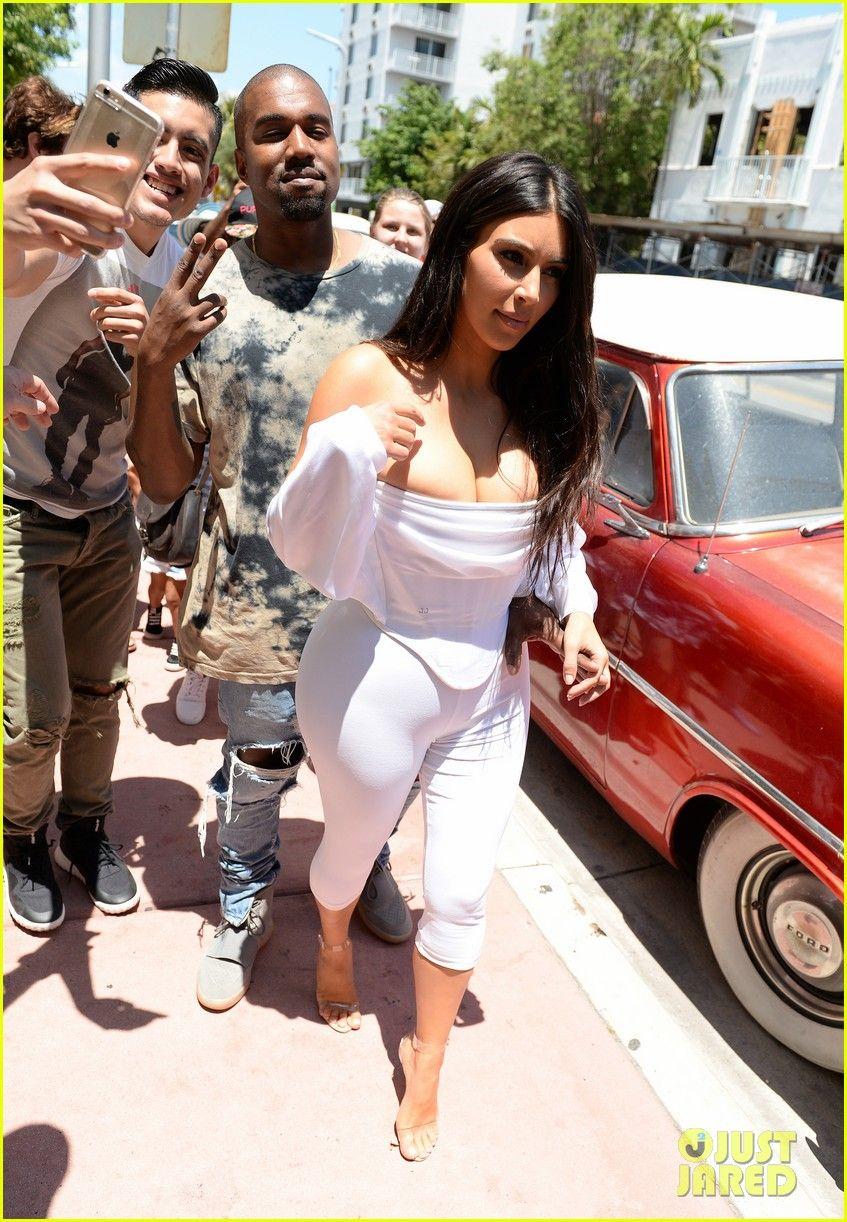 000bc50fbe3 Kim Kardashian Flaunts Curves   Cleavage in White Jumpsuit