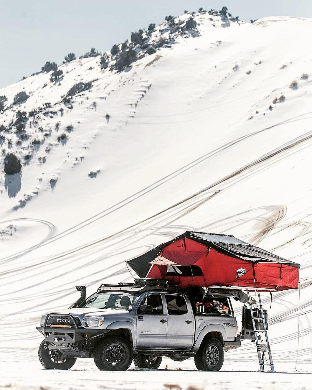 Insanely Awesome View Of The Snow Covered Sand Mountain In The Background With The Sick Rooftoptent And Rig Set U Tacoma Tent Overland Tacoma Overlanding