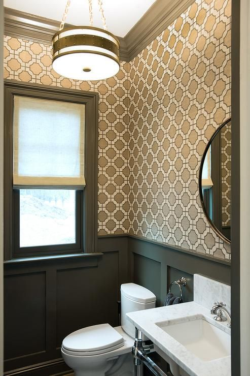 A brass chain pendant illuminates this beautifully appointed powder room clad in Phillip Jeffries Imperial Gates Wallpaper lined with dark gray crown ...