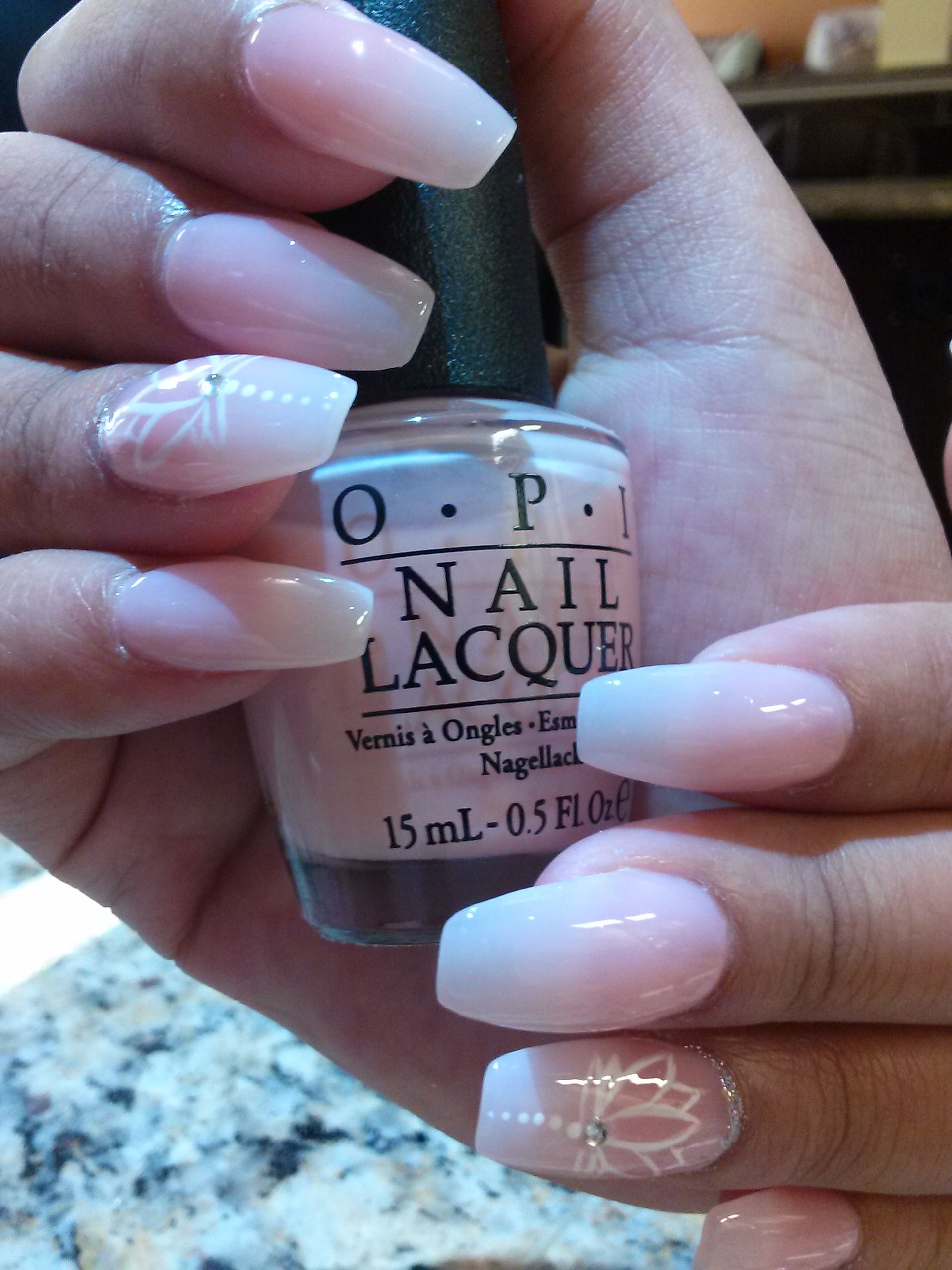 16. White Lotus: Coffin shaped acrylic nails with sheer nude polish ...