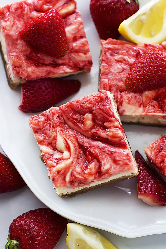 Strawberry Lemon Cheesecake Bars - thick buttery graham cracker crust topped with lemon strawberry-swirled cheesecake! Chill them for a tasty summer dessert!
