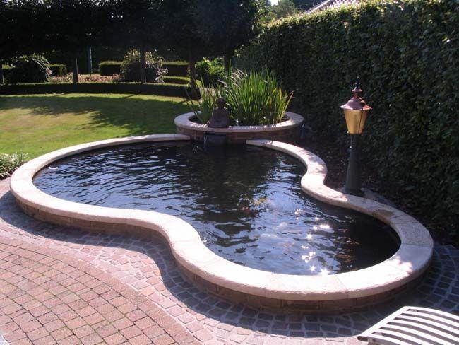 Koi pond with round shape koi beautiful koi ponds for Koi pool garden centre