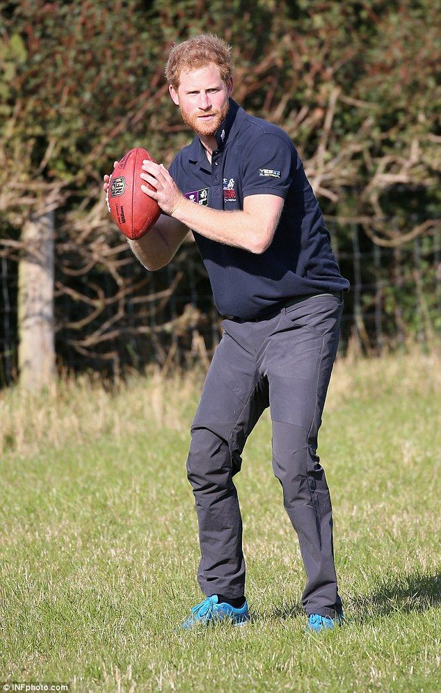 The Prince still finds some energy to throw a rugby ball around despite his exertions on the route