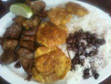 Haitian fare: Griot (roasted pork), fried green plantains ...