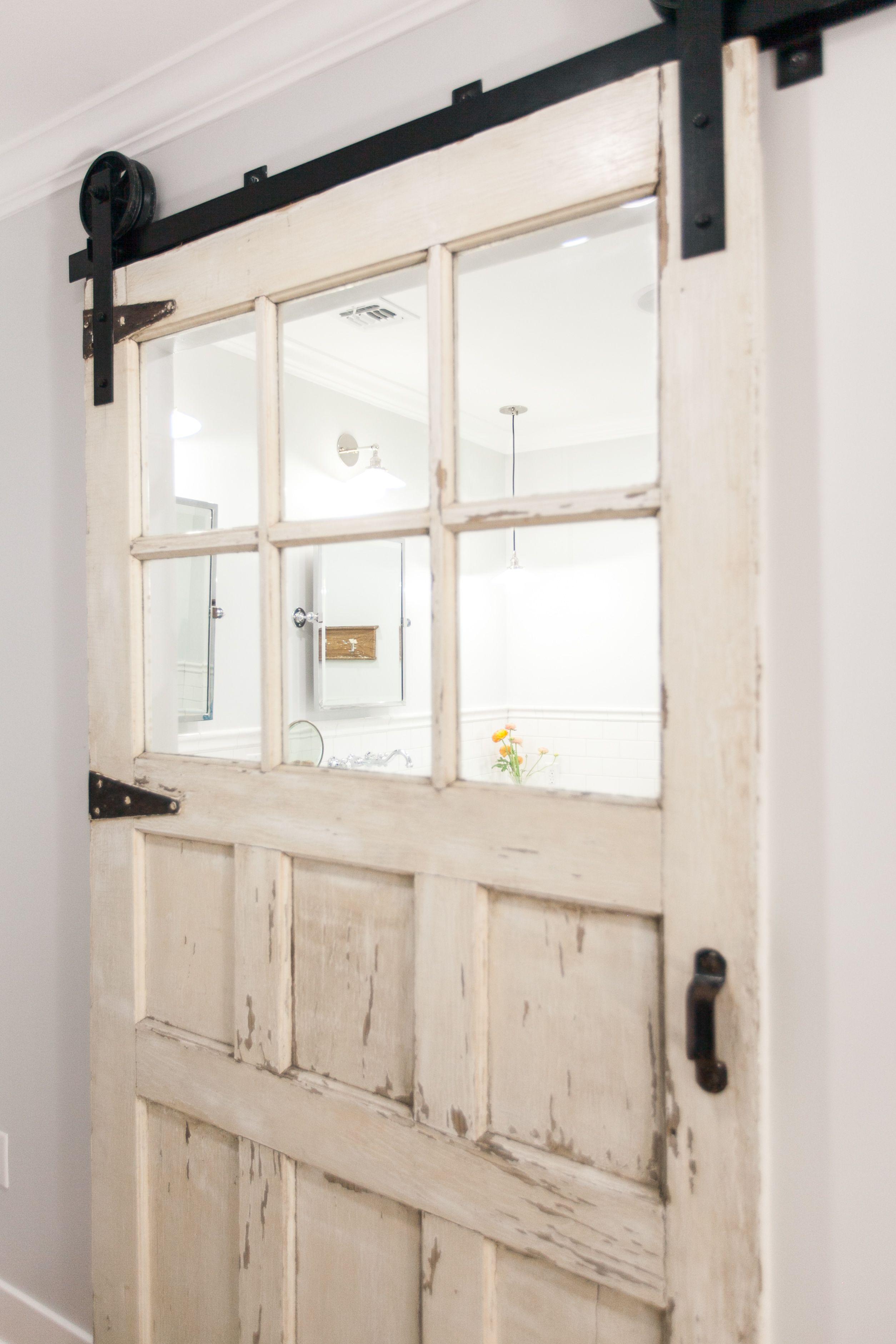 Master Bathroom Barn Door carriage style door on barn sliding track as master bath entry