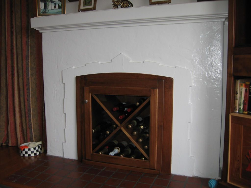 wine racks in fireplace unused fireplace converted to built in