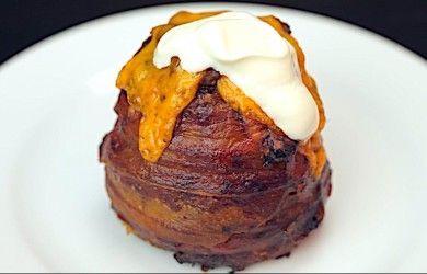 Volcanic Baked Potato | pure indulgence - baked potato stuffed with your favourite quality tasty cheese and wrapped in bacon, topped off with chilli and sour cream YUM!!