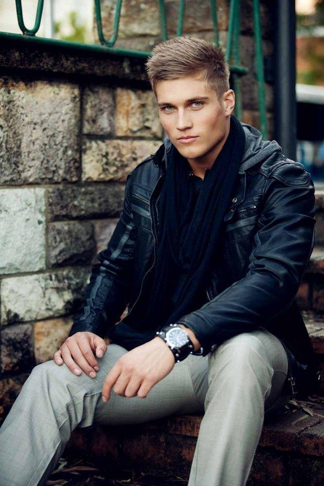 Shop this look on Lookastic: http://lookastic.com/men/looks/navy-scarf-black-biker-jacket-black-watch-grey-chinos/10105 — Navy Scarf — Black Leather Biker Jacket — Black Leather Watch — Grey Chinos