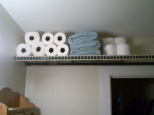 how to hang a picture without wire. spaces · use shower curtain rods to hang wire shelves - without how a picture