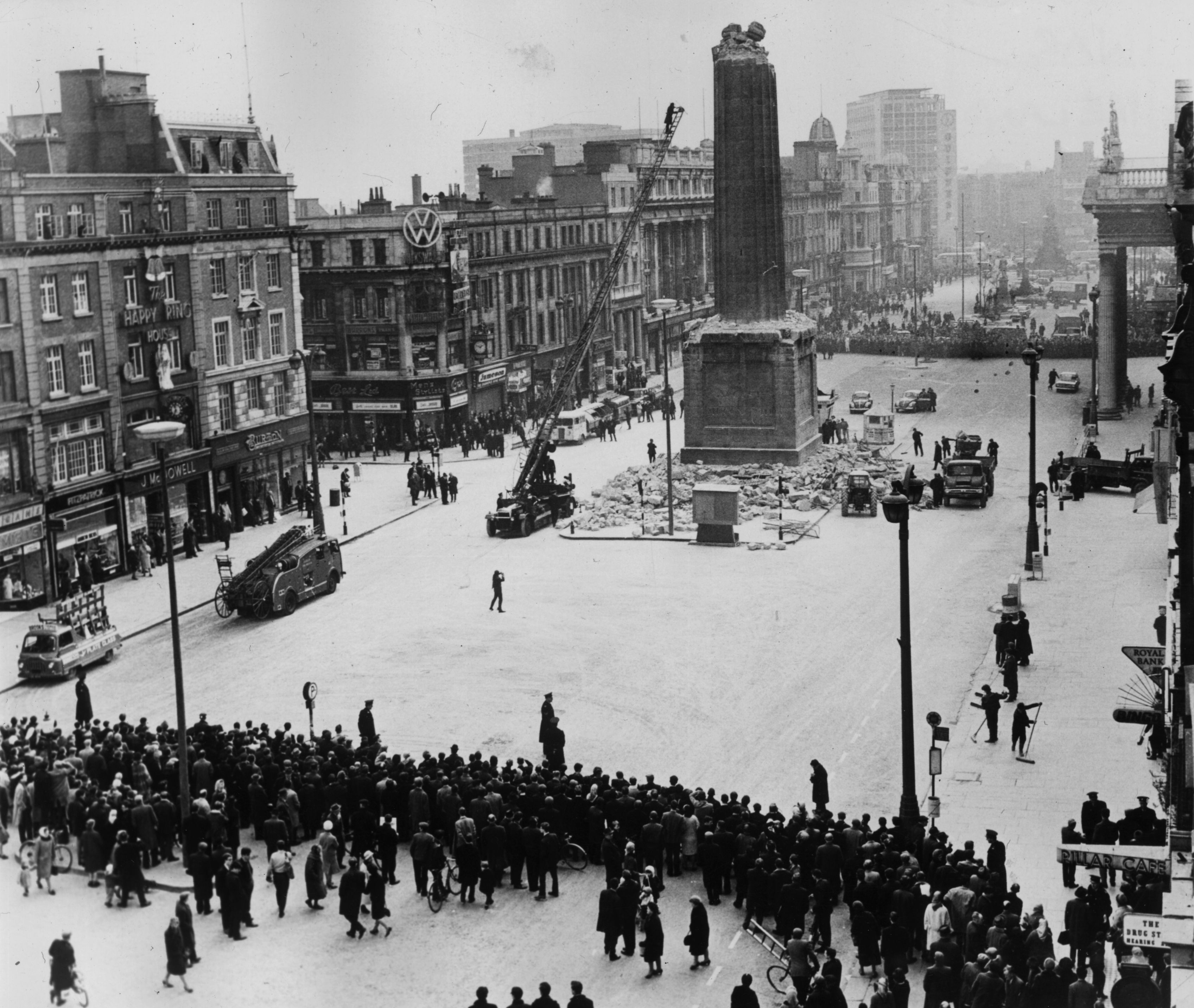 9th March 1966: During the 50th anniversary year of the 1916 Easter Rising the Irish Army remove the remainder of Nelson's Pillar in the centre of O'Connell Street, Dublin, after it was demolished by an explosion. (Photo by Keystone/Getty Images)
