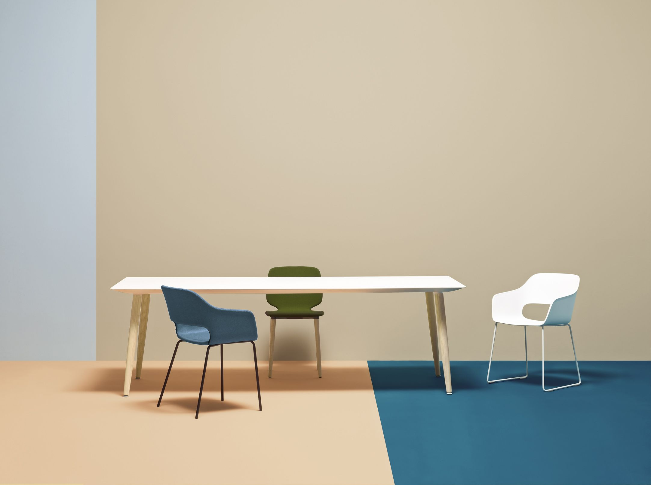 Babila meeting table with solid wood legs. Shown with Babila meeting chair range / ORDER NOW FROM SPACEIST