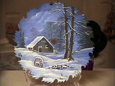 Hand painted saw blade. I have painted many of Bob Ross on saws and saw blades.