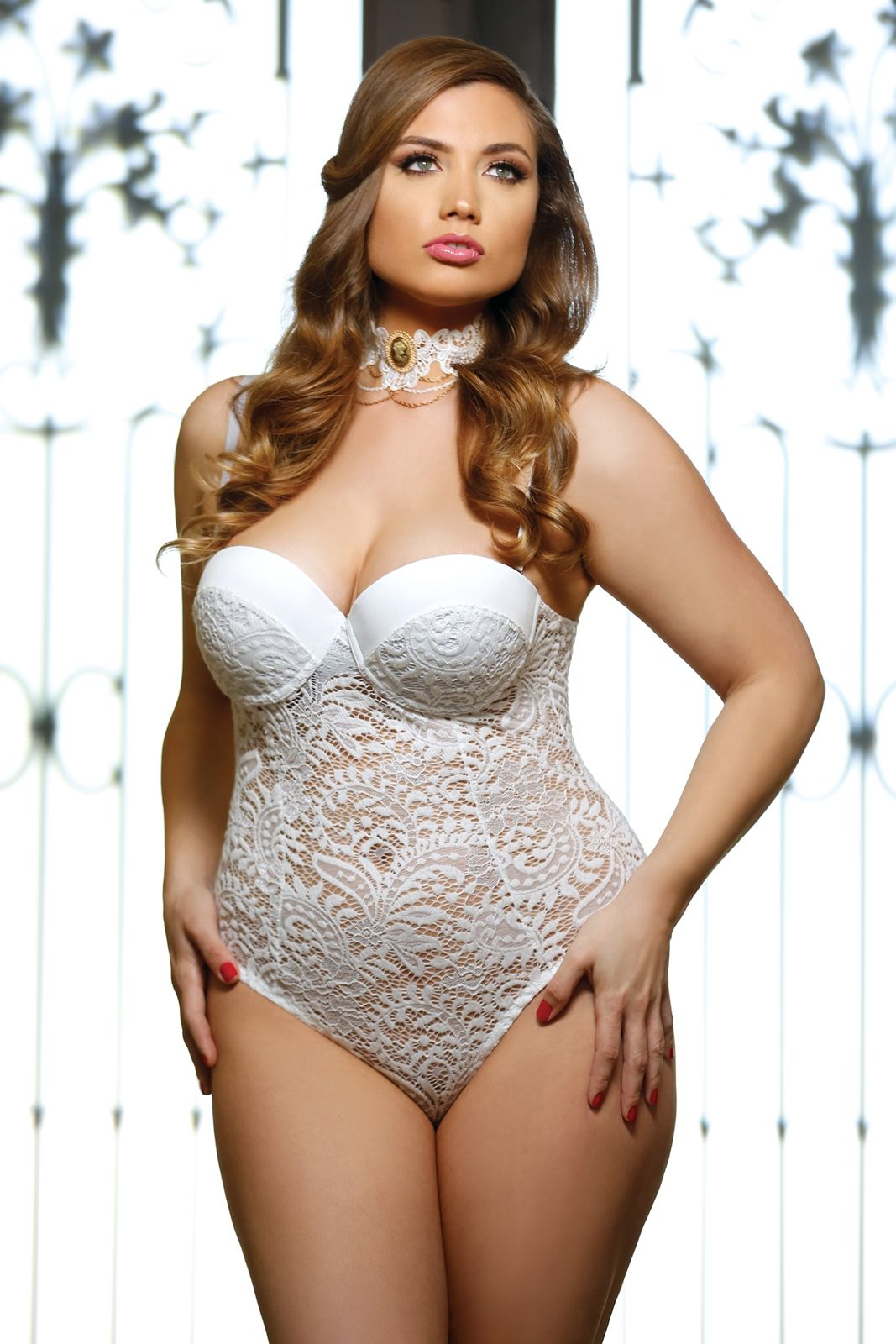 94a6ff31cde This charming Pola plus size teddy is fashioned with a built in bra and  richly luxurious