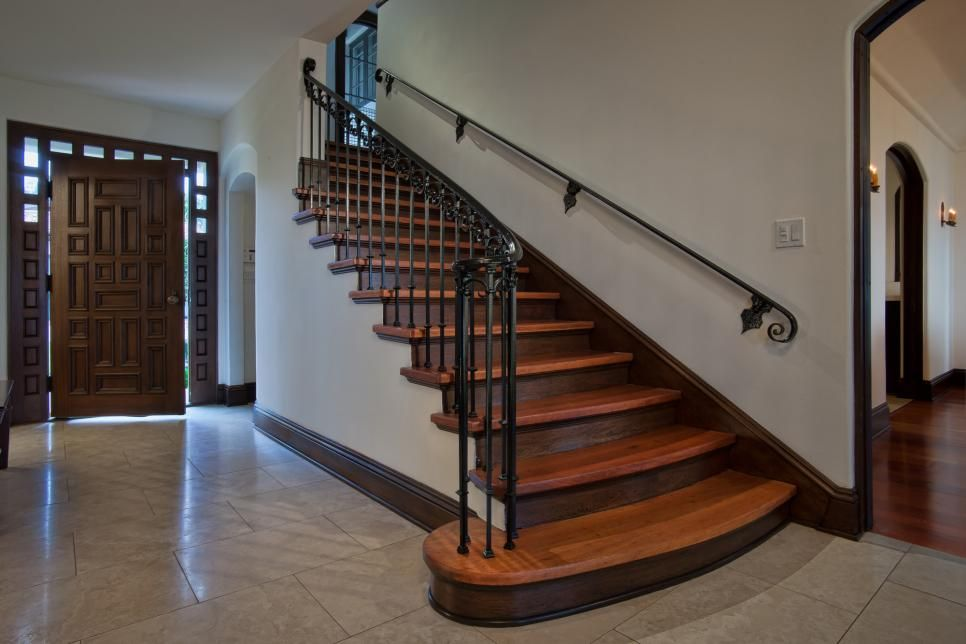 Two Toned Wood Stairs Pair With Wrought Iron Railing For An Elegant  Spanish Inspired
