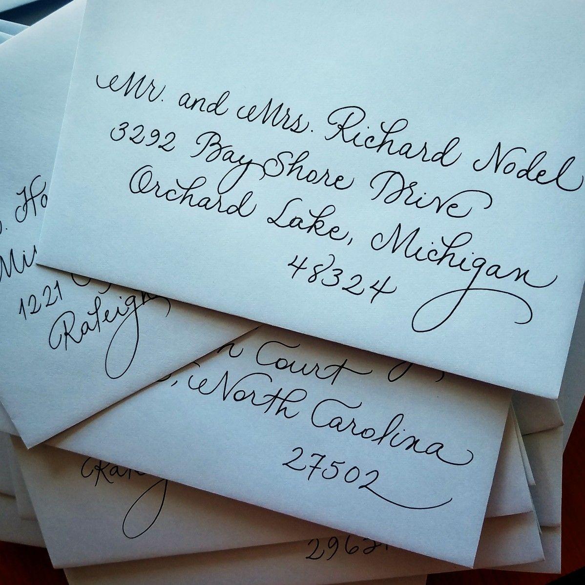 baby blue savethedate envelopes with black fancy script
