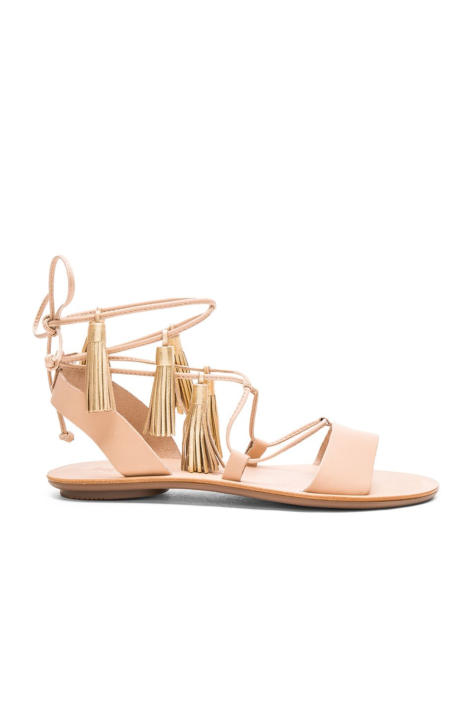 See this and similar Loeffler Randall sandals - Saffron Sandal Leather  upper with rubber sole. Lace-up front with wrap tie closure.